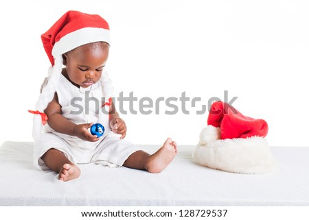 A 8 month old baby dressed to explore Christmas. - stock photo