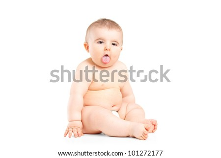 A 9 months baby boy sticking his tongue isolated on white background - stock photo