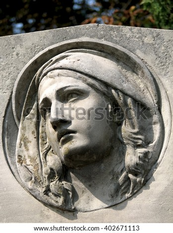 a monument to a grieving woman who raised her eyes to the sky - stock photo