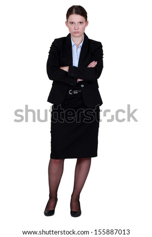 A moody businesswoman - stock photo