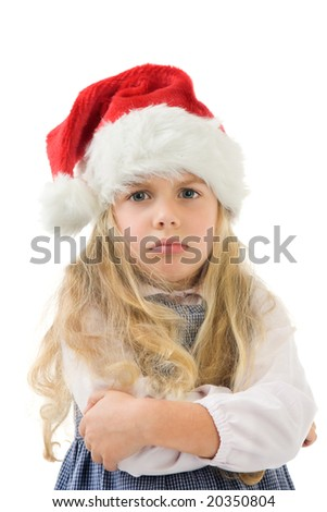 a moping  little girl with a christmas hat - stock photo