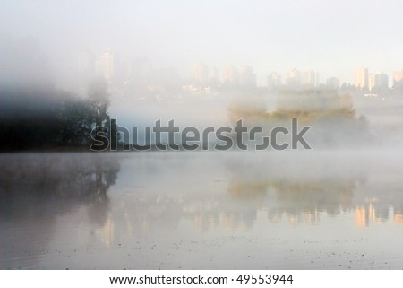 A morning fog lake view. - stock photo