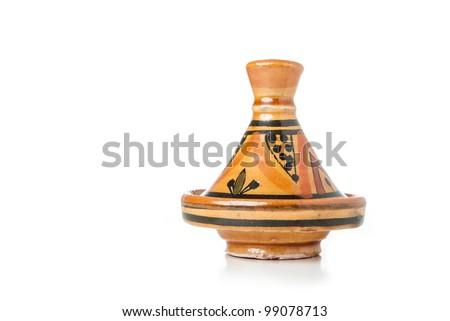 A moroccan handmade ceramic Tajine isolated on a white background - stock photo
