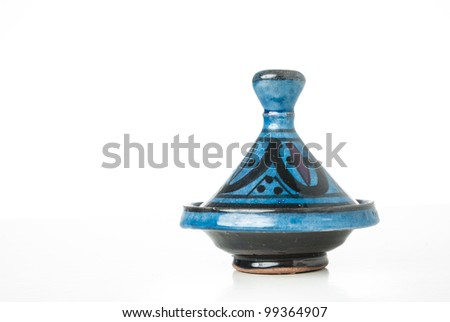 A moroccan handmade ceramic Tajine isolated on a white background - stock photo