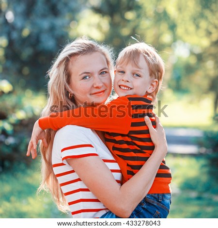 A mother and child at the her hands in nature. Children and happy family concept. - stock photo