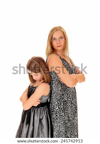 A mother and daughter standing back to back, isolated for white background, being mad to each other.  - stock photo