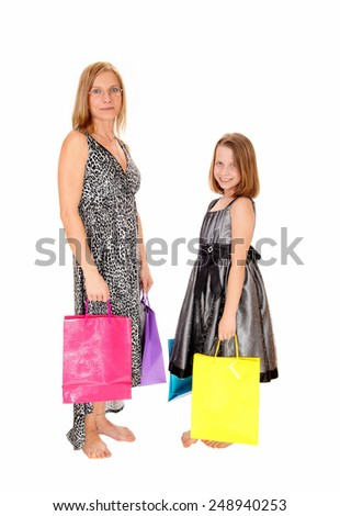 A mother and her daughter standing isolated for white background with shopping bag's in there hands.  - stock photo