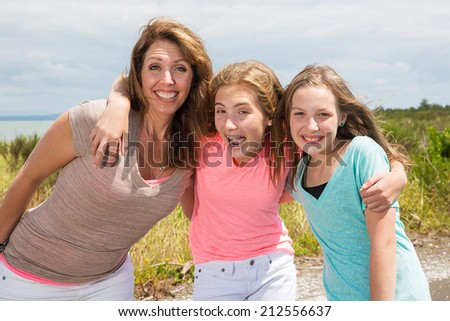 A mother and her two daughters  - stock photo