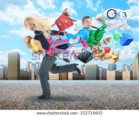 A mother is late for school and work and rushing with her children for a funny stress concept in the busy city. - stock photo