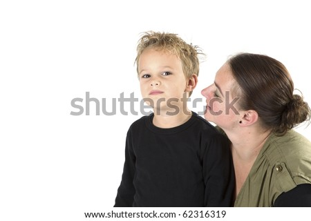 A mother is telling her son something. - stock photo