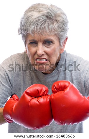 A mother shows who is boss by using her boxing gloves. - stock photo