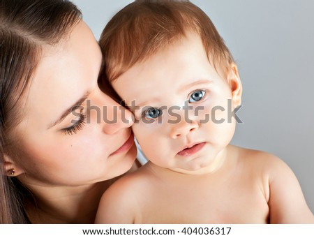 A mother with a baby in her arms - stock photo