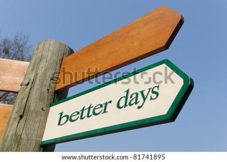A motivational green and white wooden signpost pointing towards better days on sunny blue sky - stock photo