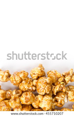 A mount of caramel popcorn . Background picture with copyspace. Isolated on white on the top. - stock photo