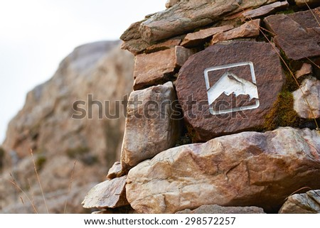 A mountain path marker, Sign in the Scottish Highlands, UK. - stock photo