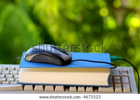 A Mouse with book making one pauses. - stock photo