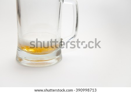 A mug of beer on a white background - stock photo