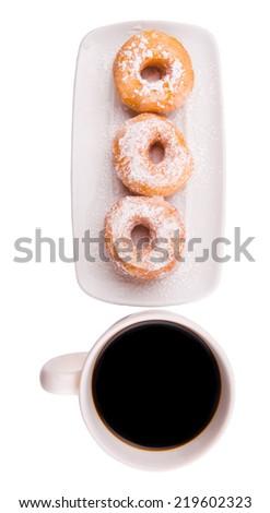A mug of coffee and homemade doughnut with sugar toppings  - stock photo