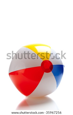 A multi-colored beach ball on a white background - stock photo
