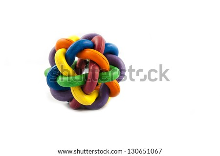 A multi coloured rubber ball dog toy - stock photo