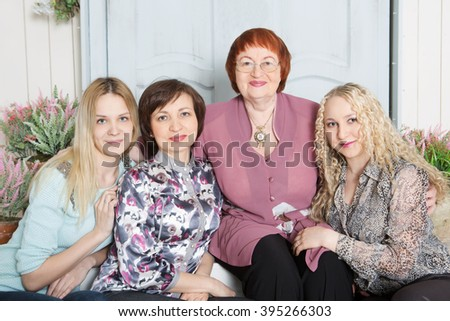A multi generation portrait of a happy grandmother with her daughter and granddaughter spending time together  - stock photo