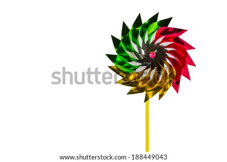 A multicolored pinwheel toy isolate white background. education, childhood and ecology concept. - stock photo