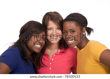 a multicultural group of beautiful female students/friends on a white background - stock photo