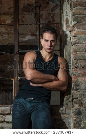 A Muscular man outdoor portrait - stock photo