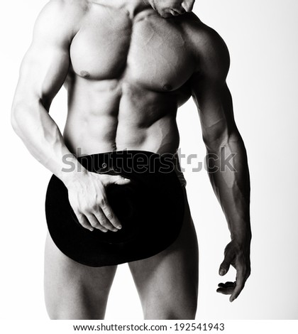 a muscular man posing artistic, on white background - stock photo