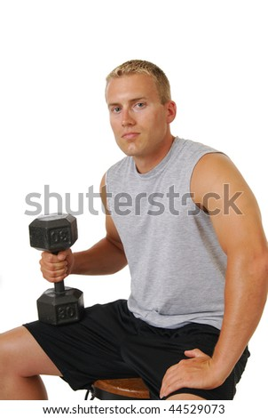 a muscular young man with a set of dumbells - stock photo