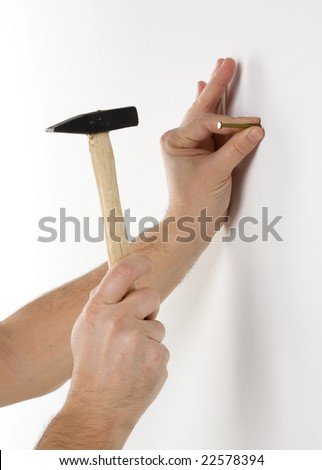 A nail is hammered into a wall - stock photo