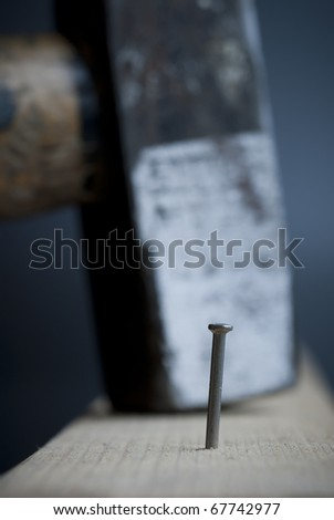 a nail is waiting for his pain - stock photo