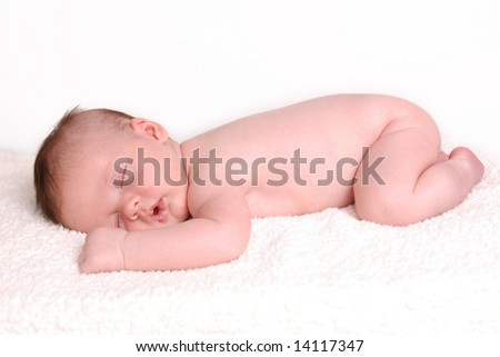 A naked baby taking a nap - stock photo