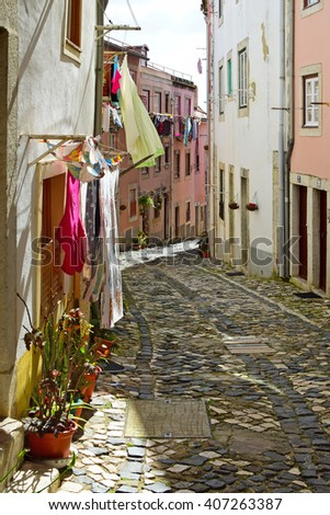 A narrow street in Alfama district in Lisbon, Portugal - stock photo