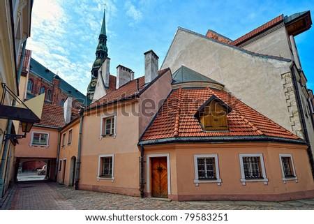 A narrow street in old town of Riga, Latvia - stock photo