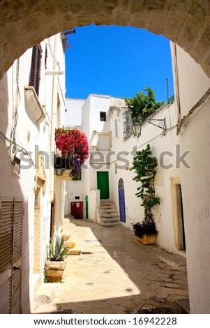 A narrow street in Ostuni, Apulia, Italy - stock photo
