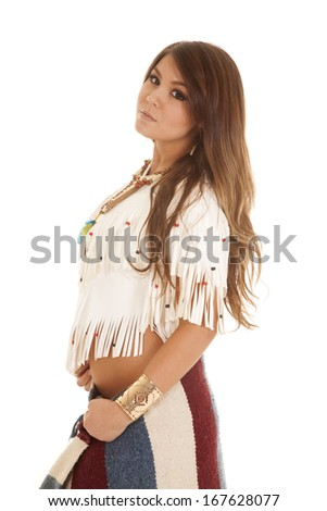 a Native American woman looking down to the side with her blanket wrapped around her hips. - stock photo