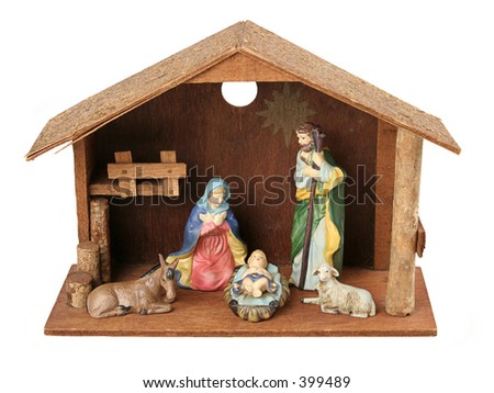 A nativity scene with just the holy family in the stable.  Isolated. - stock photo