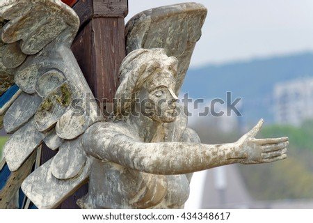 A nautical figurehead of a female angel. Carved figure made from wood mounted on a bow of a pirate ship replica. - stock photo