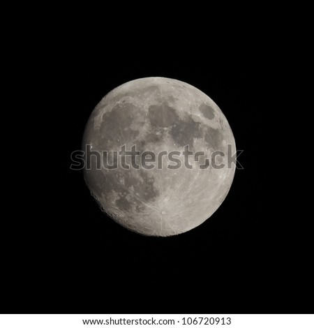 a near or almost full moon - stock photo