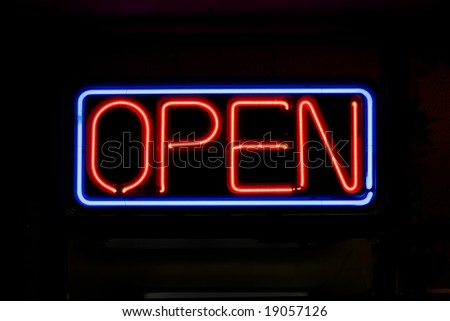 A neon OPEN sign commonly seen in businesses. - stock photo