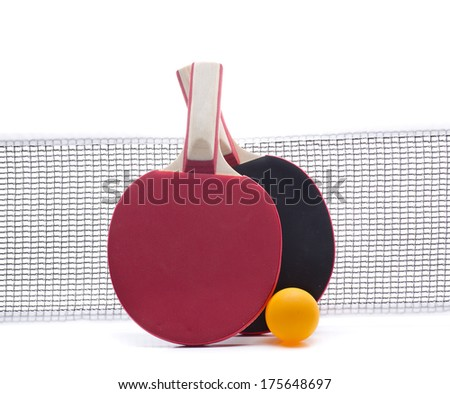 a network with two rackets and a ball to play table tennis - stock photo
