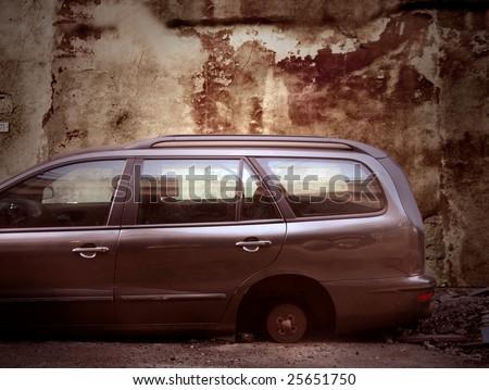 a new car with a stolen wheel - stock photo