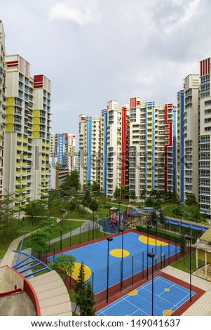 A new colorful neighborhood estate with carpark and playground. - stock photo