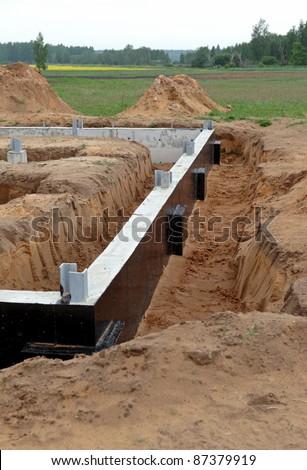 A new concrete foundation,building site - stock photo