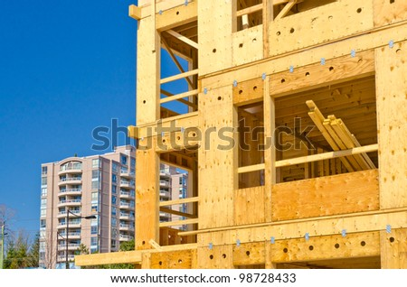 A new home under construction over blue sky in Vancouver, Canada. - stock photo