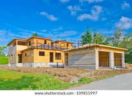 A new home with double doors garage  under construction in Vancouver, Canada. - stock photo