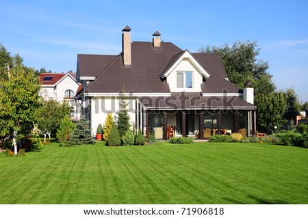 A new house with a garden in a rural area   - stock photo