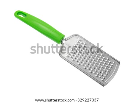 A new inexpensive cheese grater with a green handle isolated on a white background. - stock photo