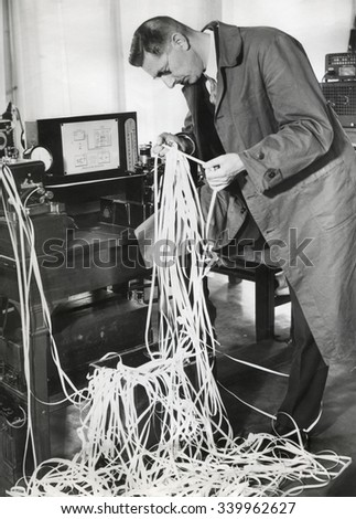 A new radio telegraph recorder is able to capture Morse messages at 5,000 words per minute. Dec. 1949 - stock photo